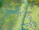 Animal Medallion turquoise & gold on green silk dupion
