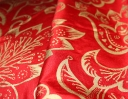 Jacobean gold on red silk dupion