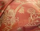Little Animals gold on burnt orange silk dupion
