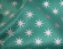 Medieval Star silver on green cotton